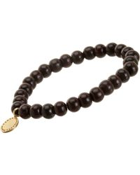 Devon Page Mccleary | Metallic Bead Bracelet With Serene Buddha Charm | Lyst