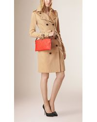 Burberry - Orange Check-embossed Leather Clutch Bag - Lyst