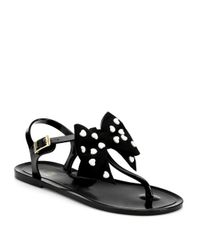 b545704f5a3d Lyst - Love Moschino Heart Bow Jelly Tstrap Sandals in Black