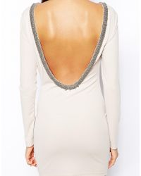 True Decadence White Bodycon Dress with Embellished Low Back