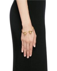 Alexander McQueen - Metallic Twin Crystal Skull Faceted Cuff - Lyst