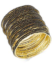 ABS By Allen Schwartz | Metallic Gold-tone Set Of 20 Black Stretch Bracelets | Lyst
