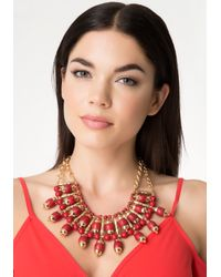 Bebe - Red Stone Sunburst Necklace - Lyst