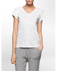 Calvin Klein | White Jeans Glitter Bamboo Print High Low T-shirt | Lyst