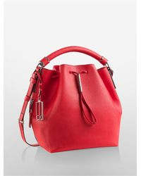 Calvin Klein | Red Galey Saffiano Leather Convertible Drawstring Bucket Bag | Lyst