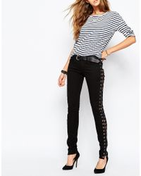 Tripp Nyc | Black Low Rise Skinny Jeans With Boho Festival Lace Up Side Detail | Lyst