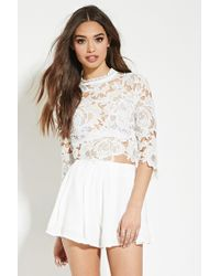 5f4b2906545b Lyst - Forever 21 Lovecat Floral Lace Romper in White