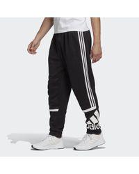 Pantaloni Essentials Logo Colorblock Cuff di Adidas in Black da Uomo