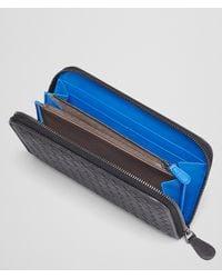Bottega Veneta Nero Signal Blue Intrecciato Washed Vintage Zip Around Wallet for men