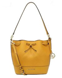Trista Medium Drawstring Saffiano and Smooth Leather Bucket Shoulder Crossbody Bag di Michael Kors in Yellow