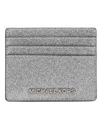 Jet Set Travel Large Leather Credit Card Holder di Michael Kors in Metallic