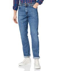 Texas Slim Indigood Jeans di Wrangler in Blue da Uomo