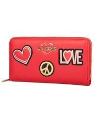 Portafoglio donna articolo JC5604PP17LJ PORTAFOGLI PU di Love Moschino in Red