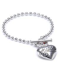 Puffy Script Heart - Bracelet - Métal argenté - 18 Guess en coloris Metallic