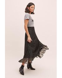 Jupe portefeuille métallisée Marjani Kirei en coloris Black