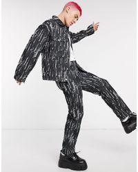 Jaded London – Drag – e Jeans mit Zierrissen in Black für Herren