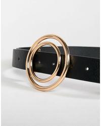 Cintura per jeans per vita e fianchi con vari cerchi di ASOS in Black