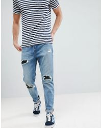 ASOS Blue Asos Tapered Jeans In Mid Wash Vintage With Faux Leather Rip & Repair for men