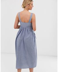 ASOS DESIGN Maternity - Robe salopette mi-longue avec poche en chambray ASOS en coloris Blue