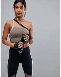 Reebok Natural Low Support One Shoulder Bra In Taupe