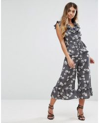 5329061e36 Lyst - Boohoo Floral Print Ruffle Edge Jumpsuit in Gray