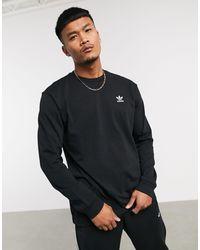 Maglietta a maniche lunghe nera con stampa sul retro di Adidas Originals in Black da Uomo