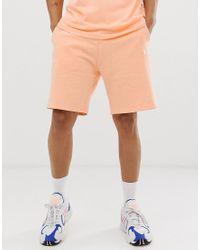 KTZ Essential - Pfirsichfarbene Shorts mit Logostickerei in Orange für Herren