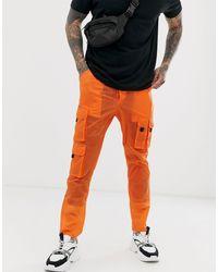 Pantalon cargo fuselé transparent ASOS pour homme en coloris Orange