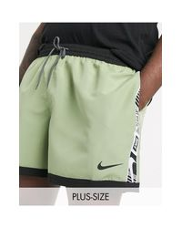 Nike Green Plus 5inch Taped Volley Shorts With Hidden Aop for men