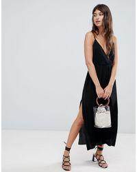 Vestido camisola largo con diseño cruzado y plisado ASOS de color Black
