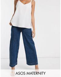ASOS DESIGN Maternity - Jeans con fondo ampio e vita alta pratici lavaggio blu medio di ASOS in Blue