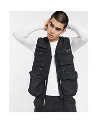 Criminal Damage – Robustes Trägershirt aus Nylon in Black für Herren