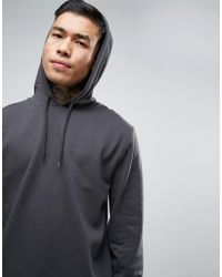 ASOS Longline Hoodie With Curved Hem In Black for men