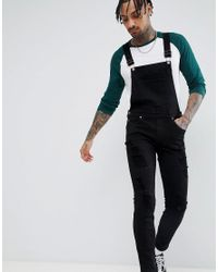 magasin en ligne accde 57f0b Ira - Salopette skinny en jean à déchirures - Noir Dr. Denim ...