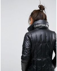 Calvin Klein - Black Jeans Long Line Padded Down Jacket With Logo - Lyst