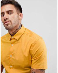 Camicia skinny a maniche corte senape chiaro di ASOS in Yellow da Uomo