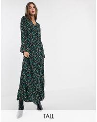 Vestito lungo a portafoglio con fondo a volant e stampa mista a fiorellini di Y.A.S in Green