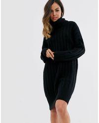 Vestito maglia a coste con collo alto nero di New Look in Black
