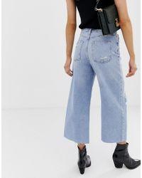Gonna pantalone blu a fondo ampio con strappi di River Island in Black