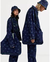 Maxi borsa oversize di jeans con stampa di Collusion in Blue
