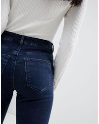 ASOS DESIGN Petite - Ridley - Jean skinny taille haute - délavé foncé ASOS en coloris Blue