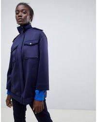 Chaqueta de neopreno con detalle de bolsillos ASOS de color Blue