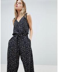 b97096ce8c Lyst - AllSaints Wide Leg Jumpsuit In Floral Print in Black