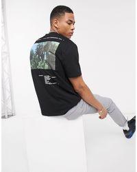 Camiseta relax con estampado en el pecho y la parte posterior Calvin Harris ASOS de hombre de color Black