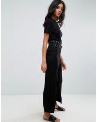 ASOS - Black Jersey T-shirt Jumpsuit With Double Belt Detail - Lyst