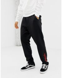 Cheap Monday joggers In Black With Zips for men
