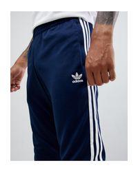 Темно-синие Облегающие Джоггеры С 3 Полосками По Бокам И Манжетами Dh5834-темно-синий Adidas Originals для него, цвет: Blue