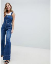 3e3110d69988 DIESEL Zip Through Denim Jumpsuit in Blue - Lyst