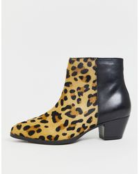 Dune Black – Stiefel aus schwarzem Leder mit kontrastierendem Leopardenmuster
