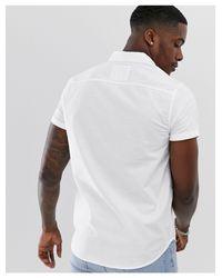 Chemise Oxford ajustée boutonnée à manches courtes avec logo emblématique Hollister pour homme en coloris White